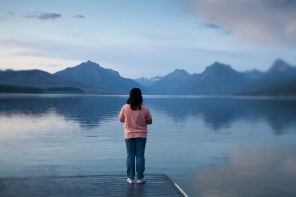 My cousin Theresa admiring the view of the mountains at Lake McDonald