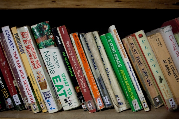 a shelf of books on food issues in the Rancho's library