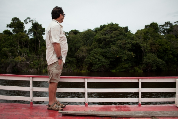 """Lalado gazing admiringly at the passing jungle from atop our river boat. I affectionately refer to him as """"the Mayor"""" since he makes friends with everyone is always connecting people."""