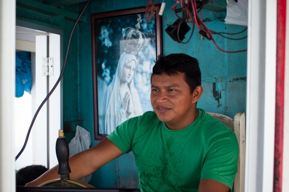 One of our two pilots with a poster of a Statue of the Virgin Mary behind him. Catholicism is still a strong presence in many Indian communities although Evangelical Christians are gaining a foothold in some villages. Most Indians believe in God but also subscribe to their own Indian spiritual beliefs.