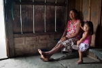 An Indian woman in the Ilna do Catanheina community discussing effects of climate change such as the increase in ants and mosquitos.
