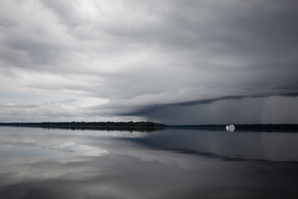 A river boat dwarfed by the approaching storm. We got caught in several rainstorms on our journey up the river.