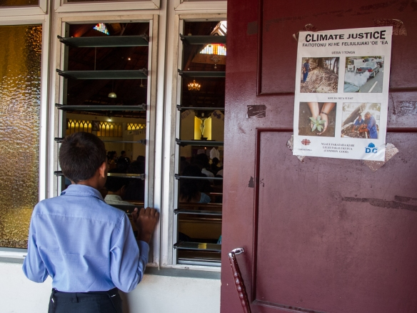 Boy and climate change poster at Catholic Church in Nuka' alofa