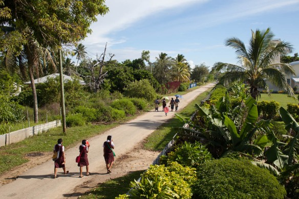 Students walking to school in Pangai under the heat of the morning sun