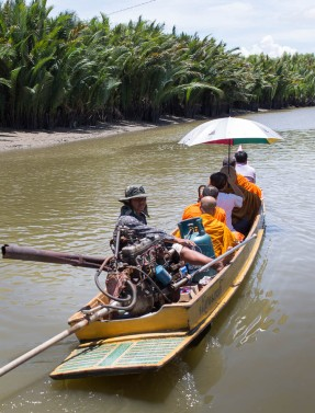 Some of the monks and Bongkot heading out on a canal on a longboat.