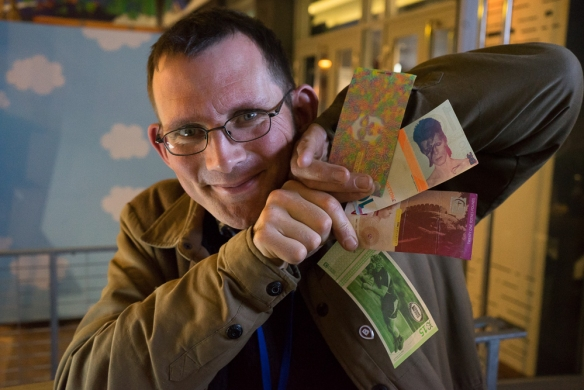 Rob Hopkins showcasing local currencies from Transition Network Towns in the UK. Yes, that is David Bowie on the Bristol pound note.